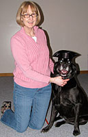 Owner with dog training graduate