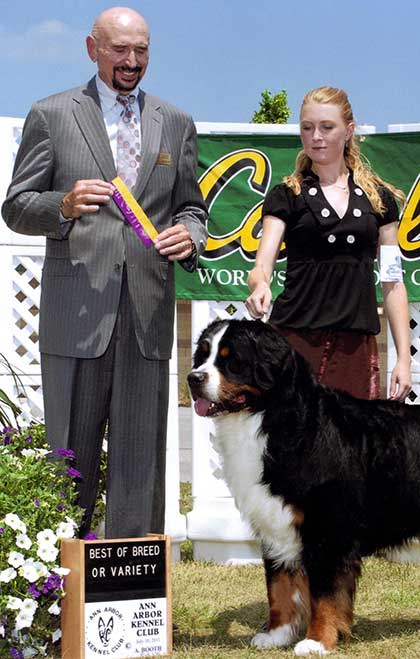 Heather with her dog Miles winning Best of Breed